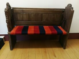 Upholstered old church pew settle with carving