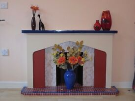 Modern fireplace mantelpiece and hearth