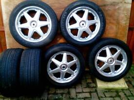 Ford alloy wheels with tyres plus two spare tyres, 5 stud 5 108 fitting.