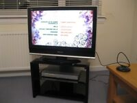 "32"" Flat screen Panasonic Viera television with glass stand"
