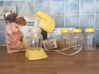 Madela Mini Electric Breastpump with extra Madela storage bottles