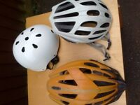Three used cycle helmets