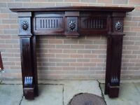 Wooden fireplace surround with marble inset, hearth and grate