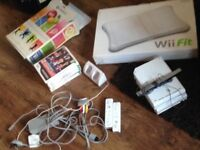 Wii for sale comes with Wii fit board game controller and other stuff