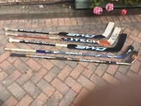 3 goalie sticks and 2 outfield hockey player sticks. Preloved!