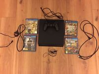 PS4 WITH FOUR GAMES (GTA 5, FIFA 17, UNCHARTERED 4 AND ROCKET LEAGUE)