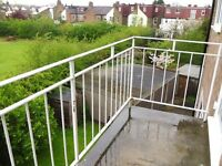 VANSTONES TO LET: COLLIERS WOOD - SPACIOUS 2 BED TOP FLOOR FLAT WITH BALCONY & OFF STREET PARKING
