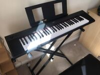 Yamaha np 12 with piano stand and stool as new condition