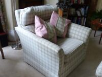 Armchair and footstool.