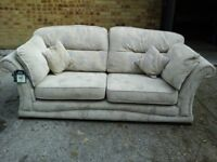 3 seater sofa in subtle grey material print with matching cushions