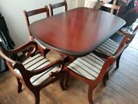 Extending dining table, 6 chairs Width 95cm length 145cm-190cm Scratches on extention. covers incl