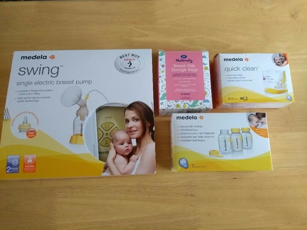 Medela Swing Single Electric Breast Pump with Calma Teat and Extra Accessories - hardly used
