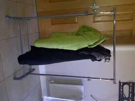 As new-Mobile wheeled adjustable height clothes rails.