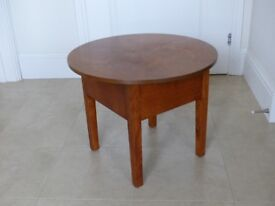 A small sewing/coffee table circa 1950