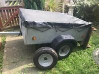 Trailer with cover and spare wheel