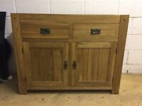 A small solid oak sideboard originally from oak furniture land. H: 83cms W: 100cms D: 43cms