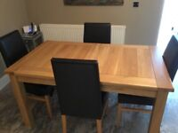 Extendable Light Oak Dining Table and Four Chairs