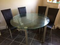 Glass table + 4 chairs. Reasonable condition. Ideal for kitchen. Drop leaf table.