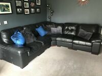 Perfect condition black leather corner sofa