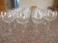 Fourteen matching wine glasses as new