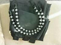 Catherine Lansfield black tab top curtains with beaded tiebacks