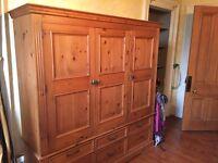 Large three door solid pine wardrobe for sale
