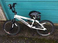 White BMX stunt bicycle, Excellent condition, Stunt pegs, spinning trick handlebars, racing helmet