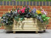 Brand new unusual 8 sided wooden garden planter.