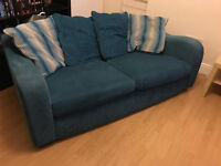 Teal blue sofa