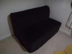 IKEA two-seat sofa bed in black, very little use