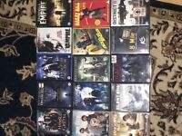 Assortment of DVDs for sale.