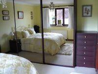 Built-in Mirrored sliding Wardrobes with Tall boy and Bedside Cabinets