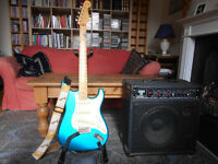 Blue 1986 Japanese Fender Stratocaster, case, Korg effects box, 100Wcombo amp, Roland mike and stand