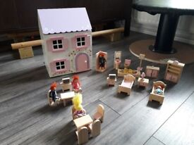 Small wooden dolls house with furnture and dolls