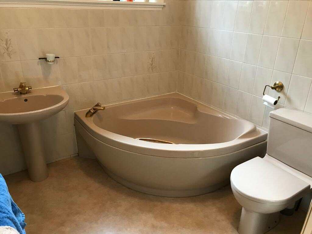 Free bathroom suite, incl corner bath, toilet and basin with ...