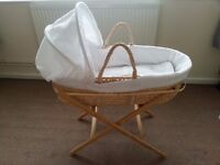2 BabyGrows + 1 Sleeping Bag + Moses Basket with a Stand & a Sheet