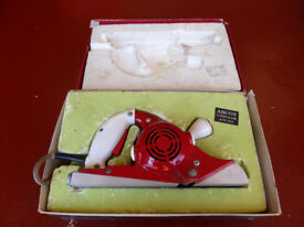 1950s electric wood planer. In original box with sharpening accessories.