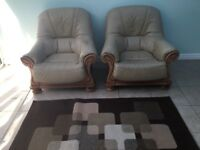 Two cream leather armchairs in good condition. Buyer collects.Tw