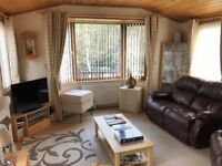 Timber Lodge. Quality residential lodge in a prime riverside location with glorious views