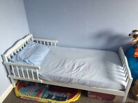 Junior / toddler bed , white wood .