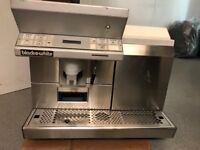 Black and white commercial coffee machine