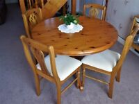 Extending Circular table & chairs, and matching display cabinet
