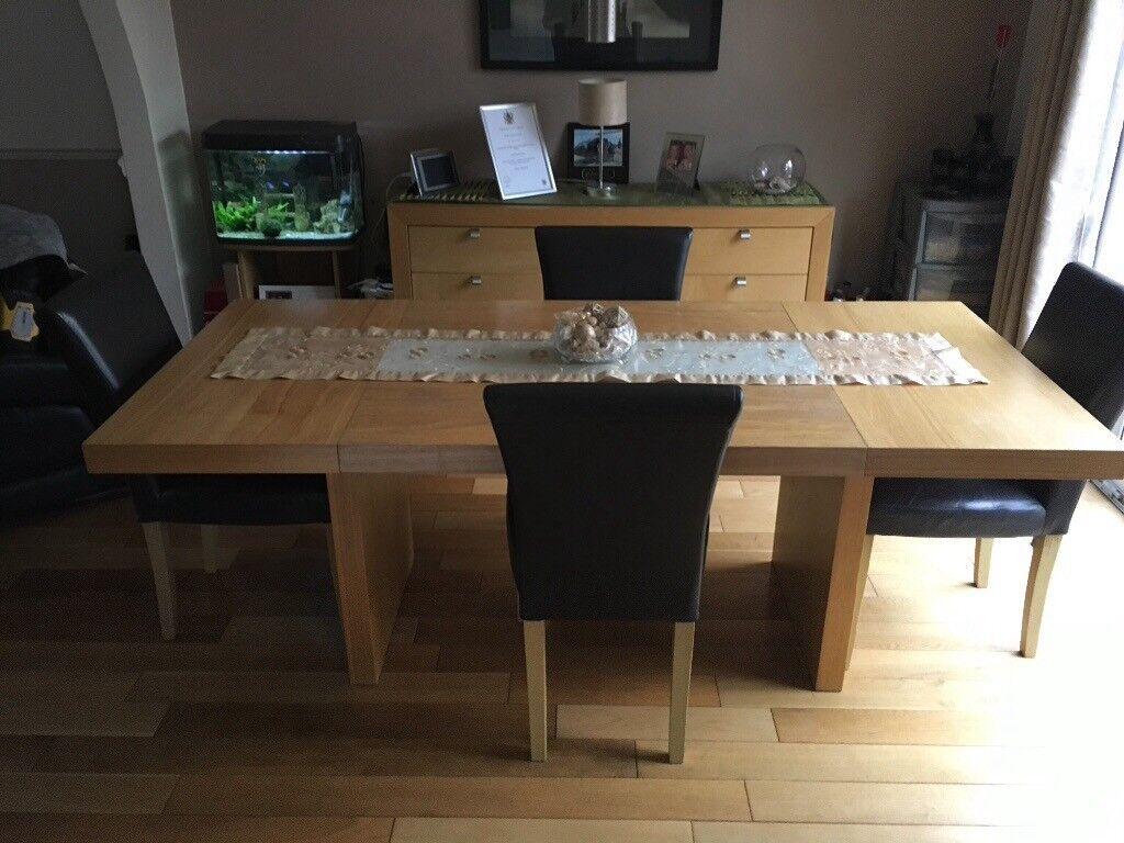 Oak veneer dining table four chairs