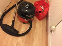 Henry Hoover, with accessories.