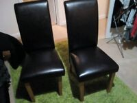 2x Dark Brown leather solid chairs