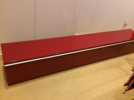 Red Ikea DVD cabinet front pull down opening. Can be wall mounted. Good condition, no marks.