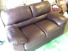 Two seater leather sofa .