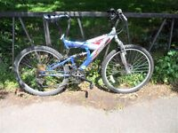 "18 Speed Suspension Mountain Bike. Fully Serviced, Ready To Ride & Guaranteed. 19"" Frame. Disk Brake"