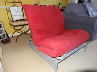Metal frame futon with thick red mattress. Great condition. Buyer collects £25.00