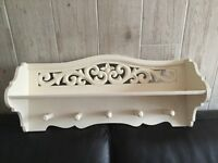 Lovely vintage cream painted shelf with ornate carving